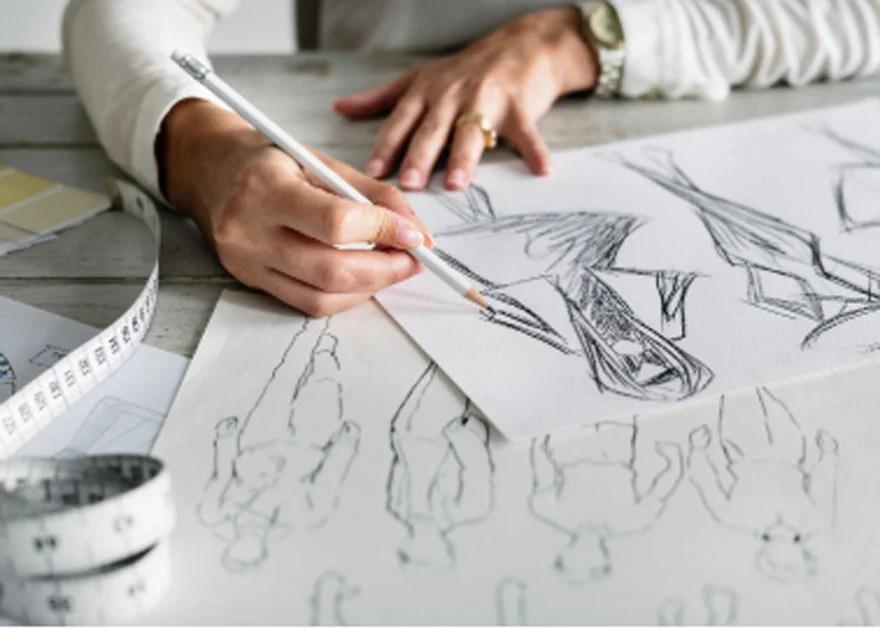 clothing designer sketching
