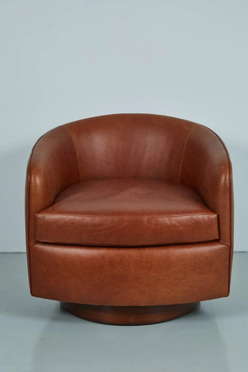brown swivel chair cba steel saddle leather chairs in the style of milo baughman orange