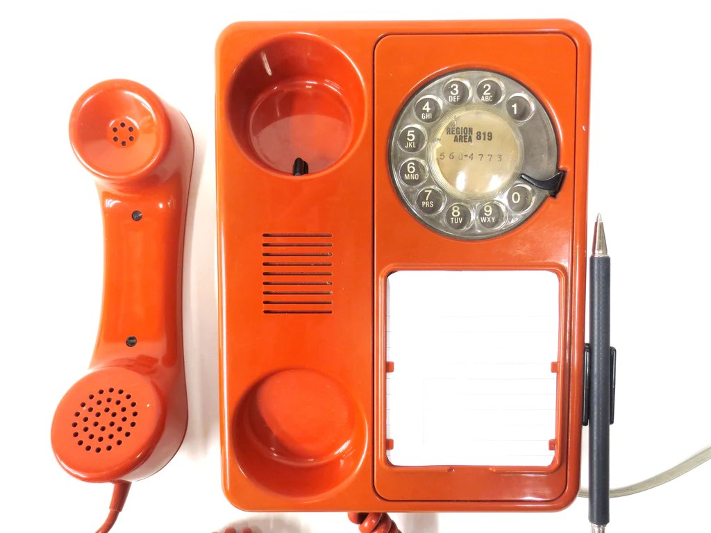 vintage mid century orange rotary phone by northern telecom pen and pad [ 1024 x 768 Pixel ]