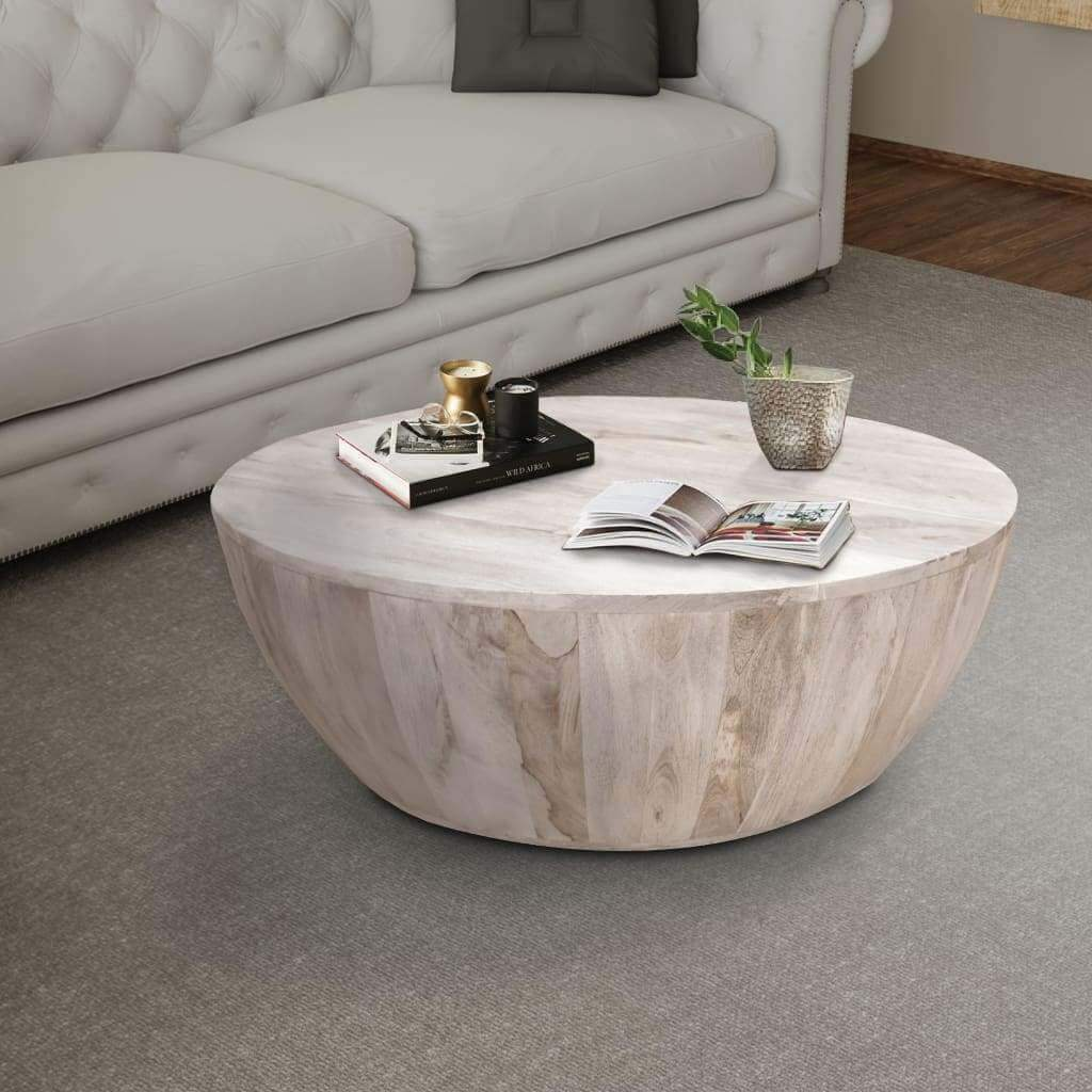 distressed mango wood coffee table in round shape washed light brown by the urban port