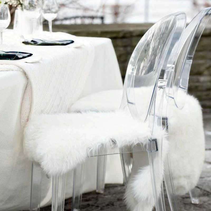 faux fur chair cover cow hide chairs lush white ivory deene sheepskin on a ghost next to table setting