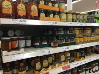 Supermarket honey on shelves in Sainsburys supermarket UK