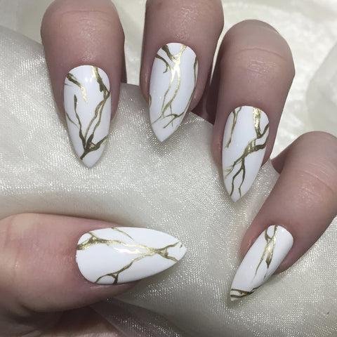 white and gold marble stilettos