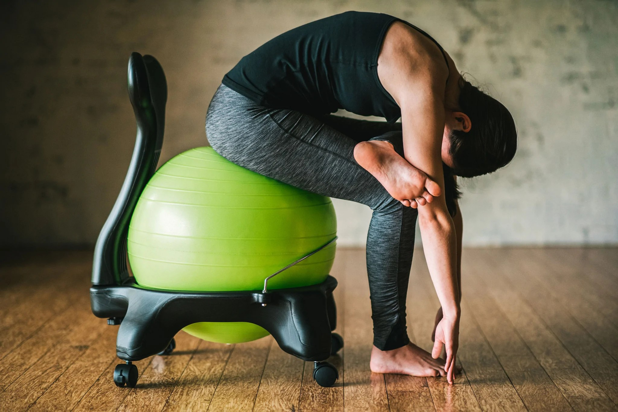 3 Stretches to Beat Back Pain without Getting Up from Your
