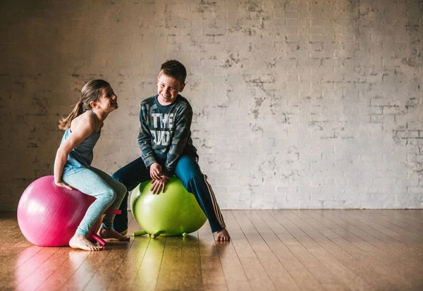 How Sitting on a Ball Helps Kids Focus and Do Better In School  Gaiam