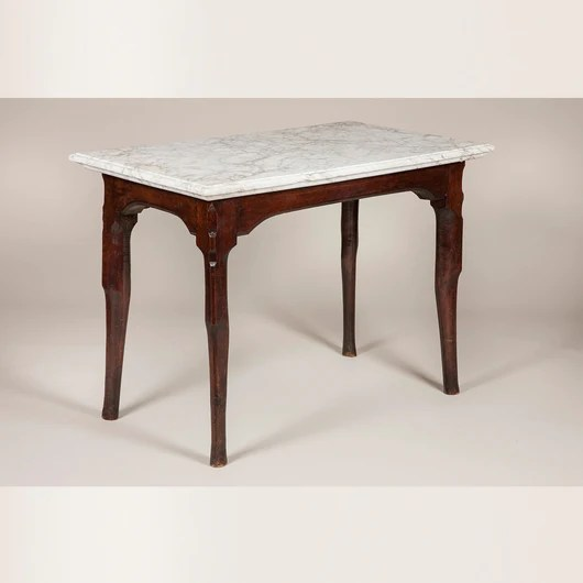an 18th century french oak console table with unusual stepped pied de biche legs and original marble top