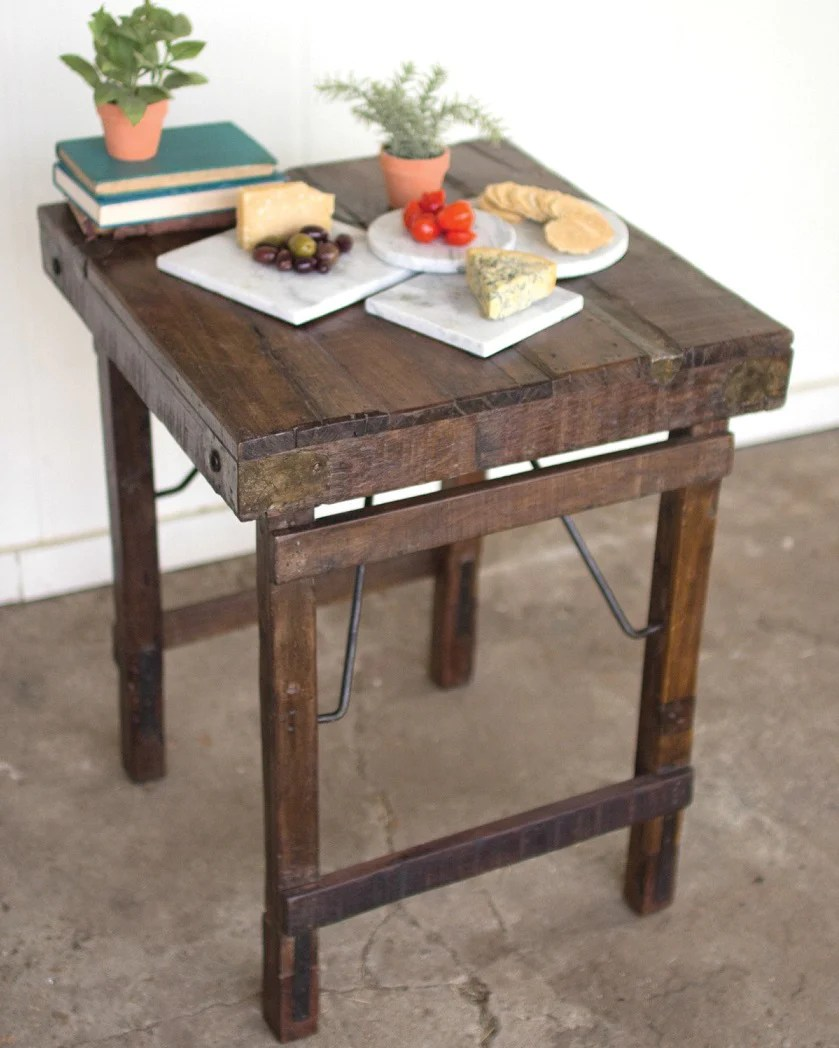 rustic wooden plank table with folding legs