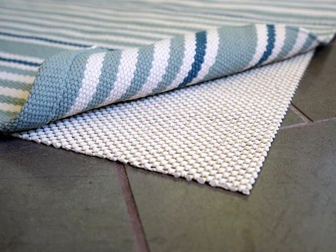 how to keep rugs from slipping on tile