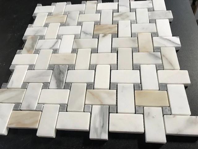 calacatta gold calcutta marble basketweave mosaic tile with grey dots