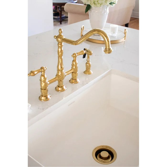 kingston brass heritage 8 inch bridge kitchen faucet with brass sprayer