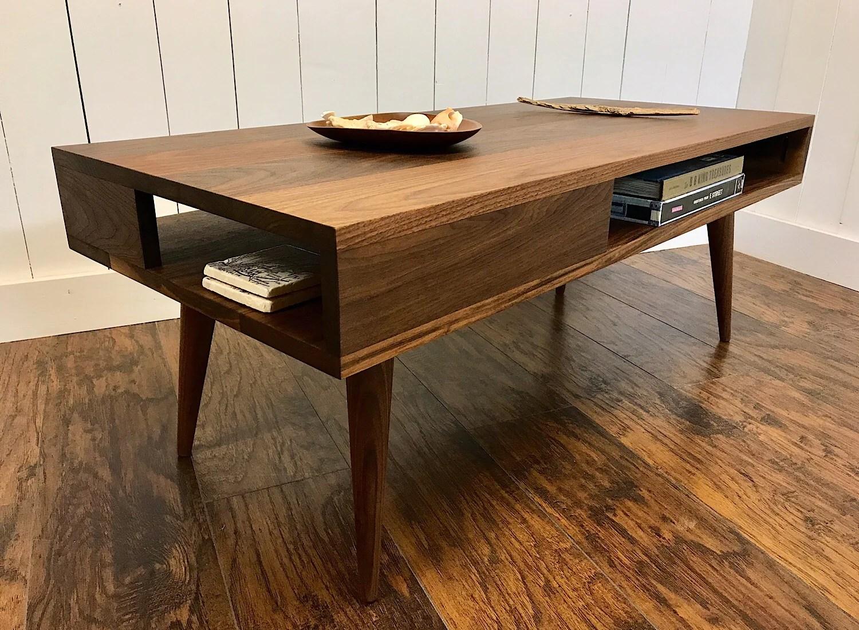 thin man solid walnut coffee table with storage