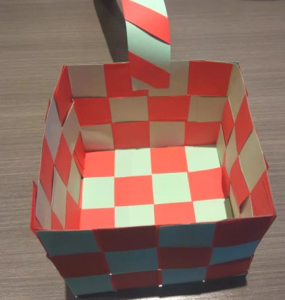 Attaching the candy cane striped basket handle
