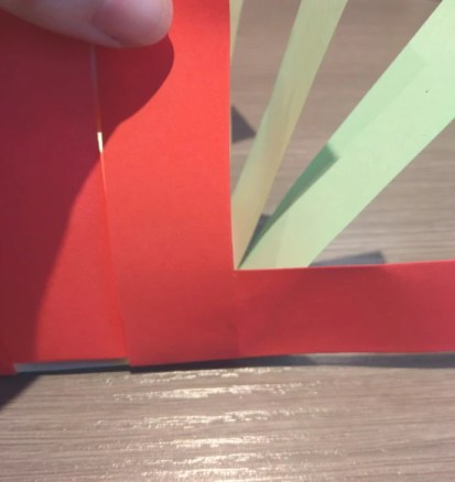 First side weaving strip taped behind corner strip