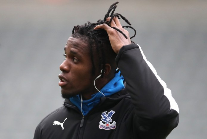 Wilfried Zaha is one of nine Crystal Palace players who will miss out against Manchester United. (Photo by Ian MacNicol/Getty Images)