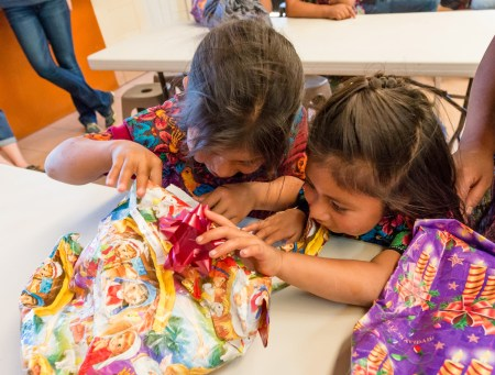 AMG International Gifts Bundles of Love to Those in Need this Christmas