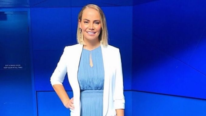 Jelena Dokic, who has an estimated total net worth of $5 million, in a blue dress and white sweater.