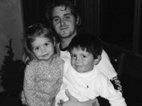 Carys took a picture with her siblings during her early years