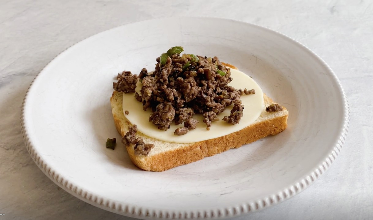 Meat filling for ground beef sandwiches on top of cheese and bread