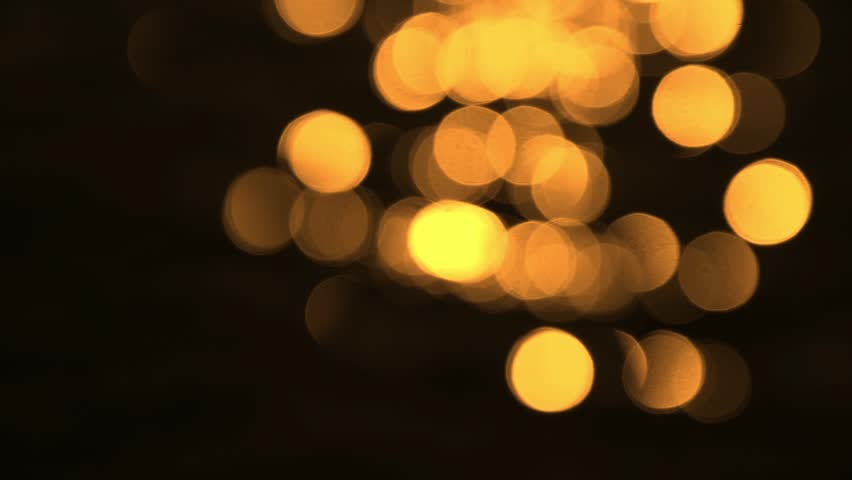 Lens Blur Of Golden Moving Lights Stock Footage Video