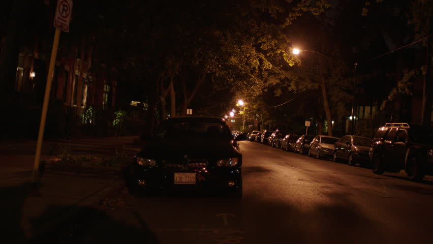 Car Parked At Night Wallpaper  A Suspicious Man In A Hooded Sweatshirt Walks Away Down A