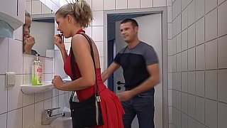 Lady in Red gets her ass fucked in Toilet. Swallow image