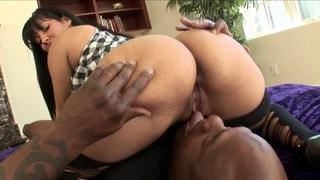 Squeezing his dick between her huge cheeks image