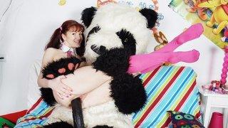 Sexy_girl_fucks_with_nasty_panda_bear image