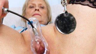 Blonde_granny_nurse_self_exam_with_pussy_spreader image