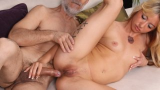 Image: Kinky blonde babe fed with big mature cock in all holes