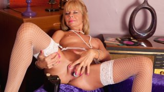 Image: Mature milf cums on her toy