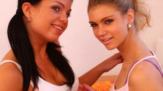 Hot lesbians tease with tongues image