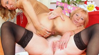 Hairy_mom_gets_toyed_by_kinky_blonde_mom image