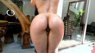 Image: Nikki Lima plays with her perfect ass and gets oiled up