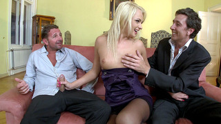 Image: Ivana Sugar grabs two cocks and starts sucking both of them