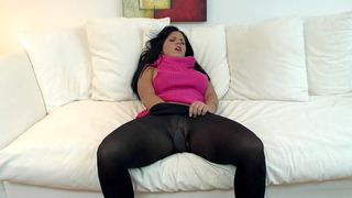 Image: Missy Maze slides her hand into her stockings and starts masturbating