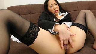 Japanese secretary in nylon stockings fingers her hairy cunt image
