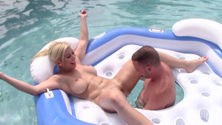 Busty girl Cristi Ann has her cunt licked in the pool image