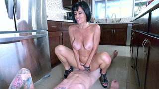 Veronica Avluv wearing nothing but high heels rides him in the kitchen image