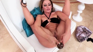 Image: Blonde Sheena Shaw stuffs her ass with huge toys