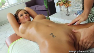the horny pornstar Phoenix Marie erotic oiled massage image