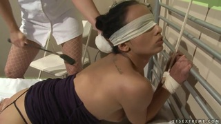 Katy Parker gives sexual treatmend by nurse Kerry image