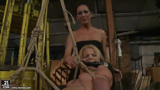 Image: Bianka Lovely shows Mandy Bright the meaning of femdom