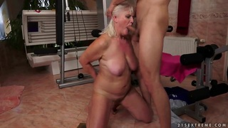 Image: Nasty granny Judi is being fucked by some young fellow and his cock