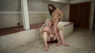 Vicky Braun and Norma having some good time together in the shower image