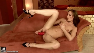Gitta Blond fucks her pusy with a red sex toy image