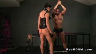 Tied up slave_gets cock flogged and ass plugged image