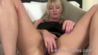 Image: Full-bush big breasted MILF Vanessa masturbates