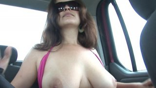 Hot lady with big boobs is touching herself in the_car image