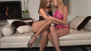 Image: Gorgeous lesbians are having passionate sex on the couch