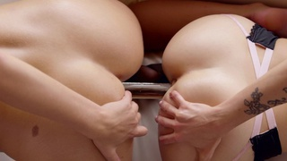 Karla Kush and Scarlet Red use their magic mouths and a double headed dildo to satisfy their cock... image